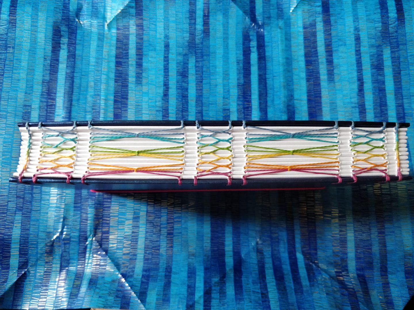 Avalon Rainbow Notebook from The Citrus Book Bindery Rainbow Stitching on Spine