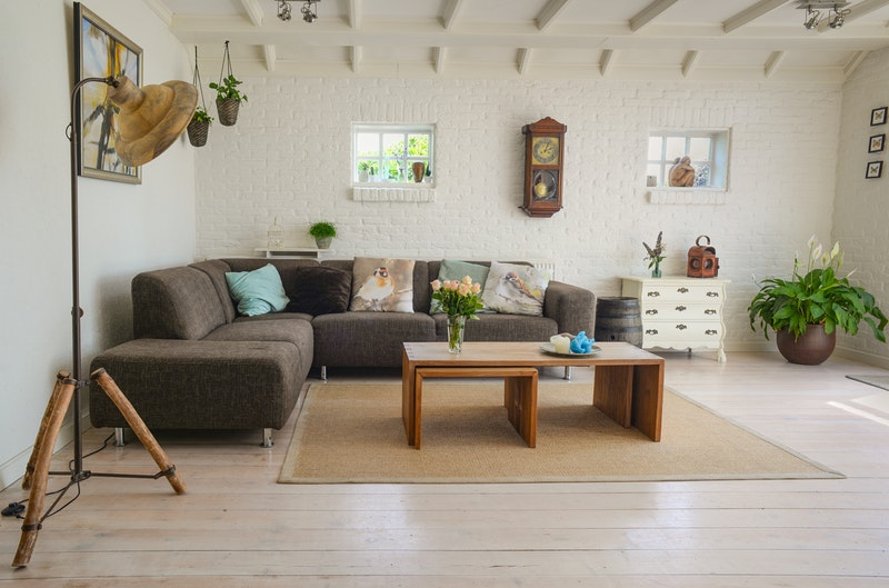 a spacious cosy lounge with sofa
