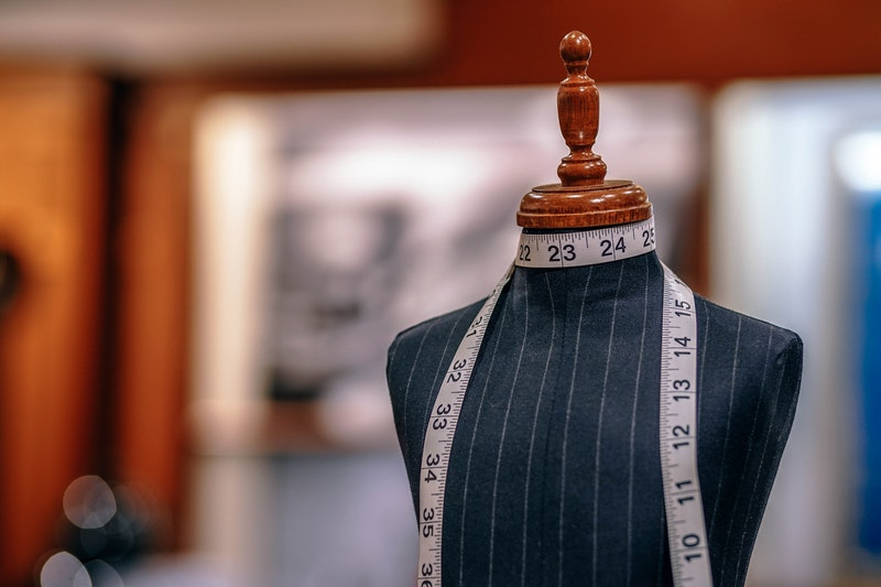 tailor mannequin and tape measure